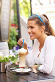 Young woman drinking coffee in a cafe Stock Photo