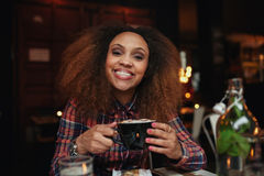 Young woman drinking coffee at cafe Royalty Free Stock Photo