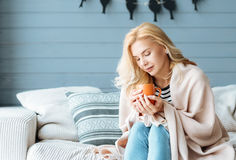 Young woman drinking coffee in cozy bedroom Royalty Free Stock Photography