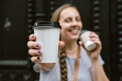 Young woman drinking coffee from disposable cup Stock Image