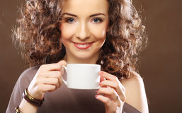 Young  woman drinking coffee Stock Photography