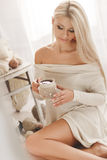 Young woman drinking coffee at home in his room. Stock Photo