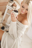 Young woman drinking coffee at home in his room. Stock Image
