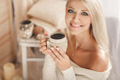Young woman drinking coffee at home in his room. Stock Images
