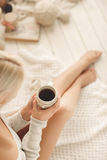Young woman drinking coffee at home in his room. Stock Photography