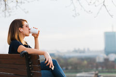 Young woman drinking coffee listening to the music Stock Image