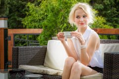 Young woman drinking coffee in the morning Stock Photography