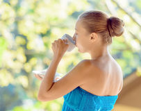 Young woman drinking coffee on morning terrace Royalty Free Stock Photo