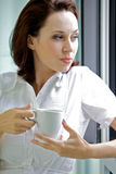 Young woman drinking coffee in the morning Royalty Free Stock Image