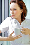 Young woman drinking coffee in the morning Stock Photo