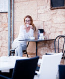 Young woman is drinking coffee outdoor in summer Stock Photo