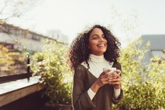 Woman enjoying a cup of coffee Stock Photo