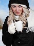 Young woman drinking coffee outside Stock Image