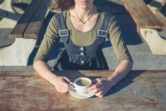 Young woman drinking coffee outside Royalty Free Stock Photos