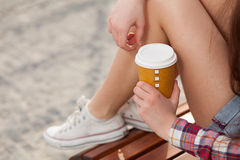 Young woman drinking coffee Stock Photos