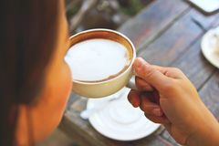 Young woman drinking coffee Stock Images