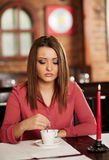 Young woman drinking coffee in a restaurant Stock Photo