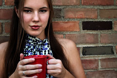 Young Woman Drinking Coffee or Tea Royalty Free Stock Photo
