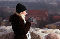 Young woman drinking coffee in Vilnius Stock Photography
