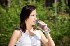 Young woman drinking cold water Stock Photos