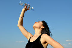 Young woman drinking cold water Royalty Free Stock Images