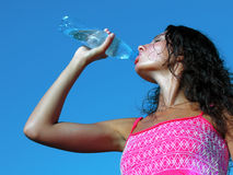Young woman drinking cold water in hot day Royalty Free Stock Photography