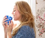 Young woman drinking a cup of tea Stock Photography