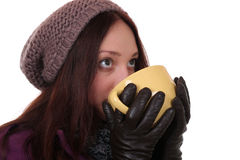 Young woman drinking cup of tea in winter and looking up Royalty Free Stock Photography