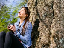 Young woman drinking and enjoying the sun Royalty Free Stock Photos