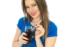 Young Woman Drinking Fizzy Cola Drink Royalty Free Stock Photos