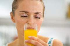 Young woman drinking fresh orange juice Royalty Free Stock Photo