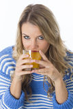 Young Woman Drinking a Glass of Orange Juice Stock Photo