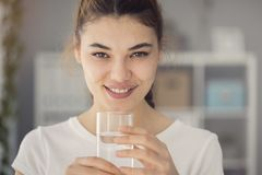 Young woman drinking glass of water royalty free stock photos