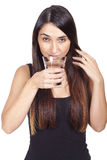 Young woman drinking a glass of water Stock Photos