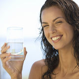A young woman drinking a glass of water royalty free stock image