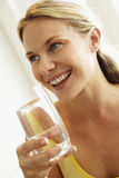 Young Woman Drinking A Glass Of Water Stock Photography