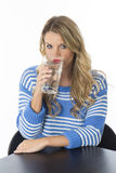Young Woman Drinking a Glass of Water Stock Image
