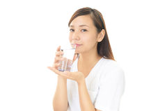 The young woman drinking a glass of water Stock Photo