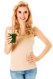 Young woman drinking green cocktail Stock Photo