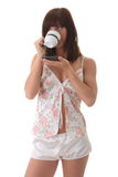 Young woman drinking her morning coffee Stock Photo