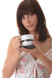 Young woman drinking her morning coffee Royalty Free Stock Photography
