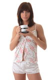 Young woman drinking her morning coffee Royalty Free Stock Image