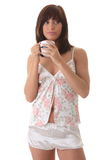 Young woman drinking her morning coffee Stock Images