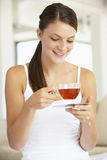 Young Woman Drinking Herbal Tea Royalty Free Stock Photos