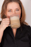 A young woman drinking a hot coffee Royalty Free Stock Photo