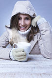 Young woman drinking hot coffee in winter Stock Photos