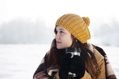 Young woman drinking hot drink outdoors. Winter collection: young woman drinking hot drink outdoors Stock Image