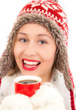 Young woman drinking hot drink Royalty Free Stock Photography