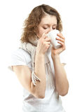 Young woman drinking hot tea Royalty Free Stock Photography