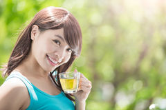 Young Woman drinking hot tea Royalty Free Stock Images